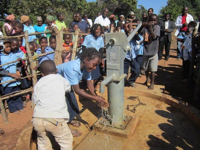 Pupils benefitting from a borehole drilled by WV